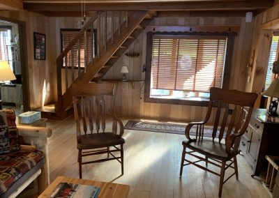 Lake House Living room with new chairs facing stairs